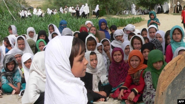 Schoolgirls study in an open air school in the outskirts of Jalalabad, Afghanistan, 11Sep2012