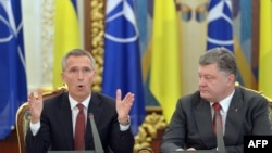 Ukrainian President Petro Poroshenko (right) listens to NATO General-Secretary Jens Stoltenberg in Kyiv in September 2015. The stripped-down July 13 meeting will be only the council's second since it resumed functioning in April after NATO suspended it in 2014 over Russia's occupation of Ukraine's Crimea region.