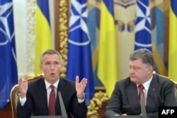 Ukrainian President Petro Poroshenko (right) listens to NATO Secretary-General Jens Stoltenberg during a National Security and Defense Council meeting in Kyiv.