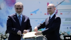 Turkish Energy Minister Taner Yildiz (left) and Rosatom CEO Sergei Kiriyenko launched the Akkuyu nuclear power plant in 2015.