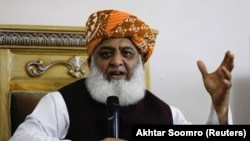 Maulana Fazlur Rehman gestures during a press conference in Islamabad on October 22.