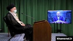 A photo showing Ali Khamenei in his COVID seclusion addressing parliament via video link. July 12, 2020
