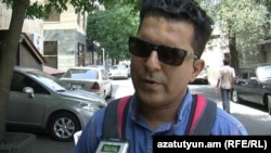 Armenia -- An Iranian man talks to RFE/RL's Armenian Service about Iran's historic nuclear deal, Yerevan, 15 Jul, 2015