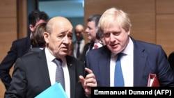 Ministrul francez de externe Jean-Yves Le Drian și omologul său britanic Boris Johnson, Luxemburg, 16 aprilie 2018.