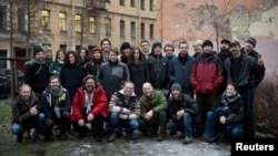 "Twenty-six members of what Greenpeace came to dub its ""Arctic 30,"" including 24 Greenpeace International activists and two freelance journalists -- in an undated photo in St. Petersburg"