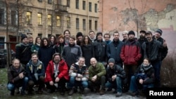 Twenty-six of the Arctic 30 (24 Greenpeace International activists and two freelance journalists) pose in St. Petersburg after their release on bail.