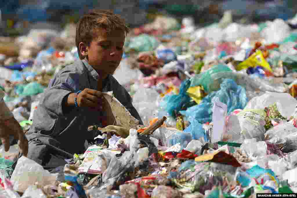 A boy collects recyclable waste from a dump on the outskirts of Karachi, Pakistan. (epa-EFE/Shahzaib Akber)