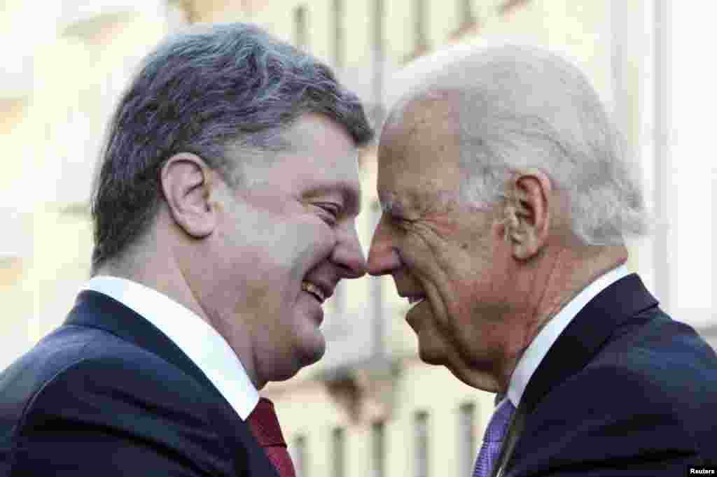 Ukraine's President Petro Poroshenko (left) warmly greets visiting U.S. Vice President Joe Biden in Kyiv. (Reuters/Valentyn Ogirenko)