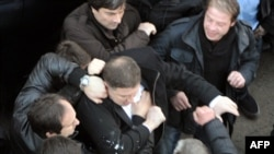 Tbilisi Mayor Gigi Ugulava (center) scuffles with protesters in Tbilisi.