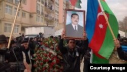 Mourners for Zaur Hasanov at a funeral procession on December 29.