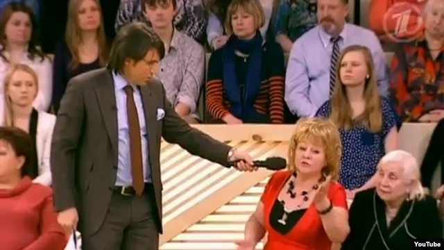 "In February 2012, Russian television's ""Let Them Talk,"" hosted by Andre Malakhov (pictured in a March 2012 broadcast), brought on Yorgin Tillaev's wife and sister to beg Nikolai Melnikov for forgiveness on prime-time TV."