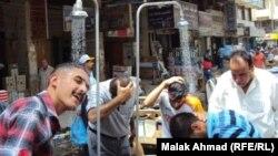 """""""دوش عالماشي"""" في بغداد صيف العام الفائت"""