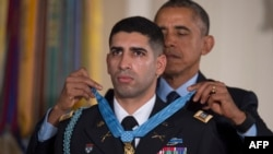 U.S. President Barack Obama presents retired U.S. Army Captain Florent Groberg with the Medal of Honor during a ceremony in the East Room of the White House in Washington on November 12.