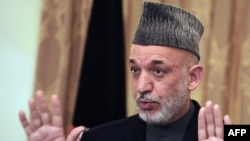 Afghan President Hamid Karzai addresses a press conference at the presidential palace in Kabul on November 23.