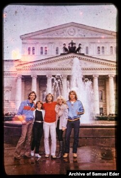 A group portrait in front of Moscow's Bolshoi Theater, likely in the 1970s.