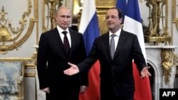 Russian President Vladimir Putin (left) met with French President Francois Hollande ahead of D-Day's 70th anniversary on June 6.