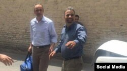 Ahmad Zeidabadi (left), a prominent Iranian journalist and political activist,on his release from prison last week. he was reportedly
