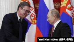 Russian President Vladimir Putin (right) with Serbian President Aleksandar Vucic in Moscow on December 19