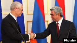 Armenia - President Serzh Sarkisian (R) and European Union President Herman Van Rompuy shake hands at a joint news conference in Yerevan, 4Jul2012.