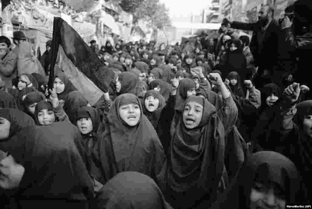 Iranian orphan girls in chadors demonstrate outside the embassy on November 27, 1979, demanding the return of the shah for prosecution.