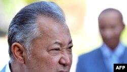 Kyrgyz President Kurmanbek Bakiev speaks to reporters after voting in Bishkek on July 23.