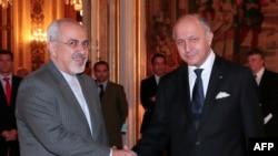 Міністри закордонних справ Ірану Могаммад Джавад Заріф (ліворуч) і Франції Лоран Фабіус, Париж, 5 листопада 2013 року