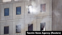 Smoke is seen during an attack on the Iranian parliament in central Tehran, Iran, June 7, 2017.