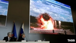 Almaz-Antey spokesman Valery Yarmolenko (left) and Almaz Antey's general director Yan Novikov showed dramatic video from an experiment in which the weapons manufacturer blew up an airliner in what it said was an attempt to gauge blast trajectories.