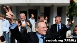 Former Belarusian presidential candidate Uladzimer Nyaklyaeu greeting supporters after being given a suspended sentence for organizing postelection protests last December.