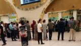 People waiting for a ticket at Ashgabat's airport in August, where there are many reports of officials refusing to let people leave.