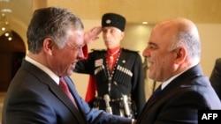 العاهل الأردني الملك عبد الله الثاني يرحب بالعبادي في عمان - 26 تشرين الأول 2014