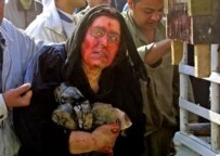 An Iraqi mother in Ba'qubah mourns for her two police officer sons who were killed in an insurgent explosion (AFP)
