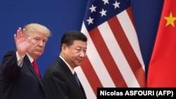 Президент США Дональд Трамп (л) та лідер Китаю Сі Цзіньпін