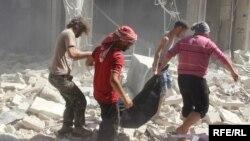 Алеппоның шығысындағы Бустан әл-Каср ауданындағы Ресей әуе шабуылдарынан кейінгі көрініс. Сирия, 11 қазан 2016 жыл.