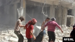 PHOTO GALLERY: Aleppo Neighborhood Pounded By Air Strikes