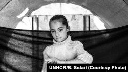 شکری هشت ساله، از پناهندگان سوری در پناهگاهی در عراق. پدر او در جنگ داخلی سوریه کشته شده است