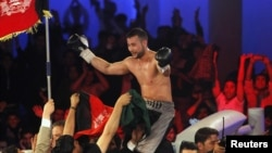 Afghan-German World Boxing Union champion Hamid Rahimi celebrates his victory over Said Mbelwa (not pictured) of Tanzania after their World Boxing Organization intercontinental middleweight fight in Kabul on October 30.