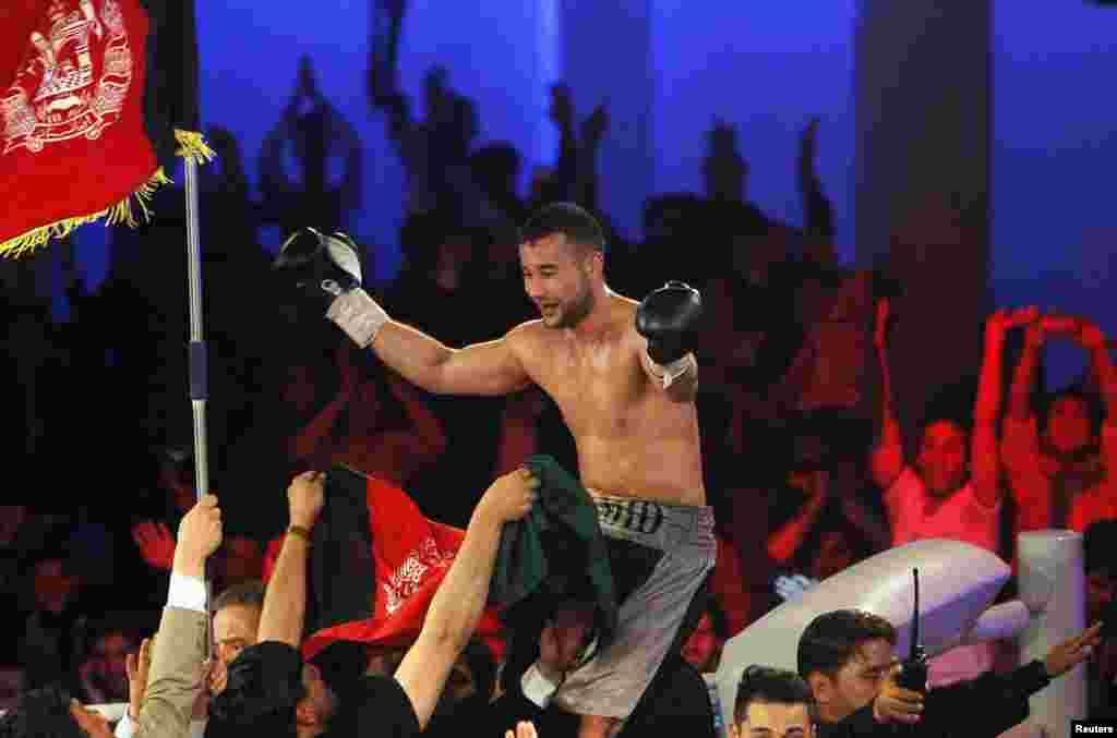 Hamid Rahimi celebrates his victory over Said Mbelwa (not pictured) after their World Boxing Organization intercontinental middleweight fight in Kabul.