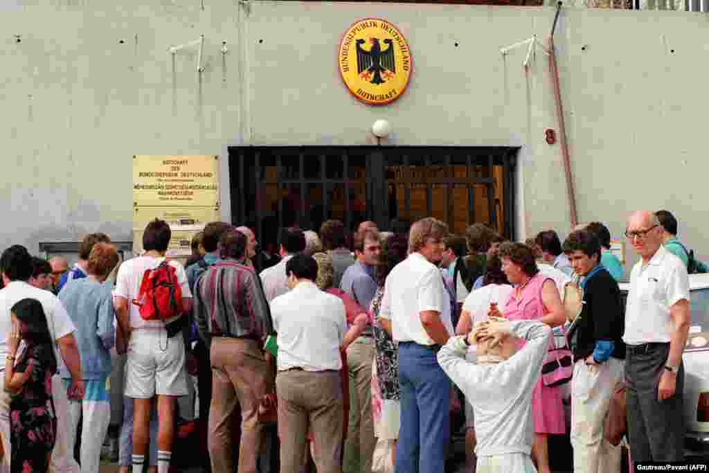 East Germans wait for visas in front of the West German consulate in Budapest on August 14.