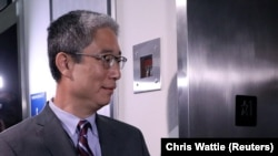 Former associate U.S. deputy attorney general Bruce Ohr enters an elevator after testifying behind closed doors before two Republican-led congressional committees on August 28.