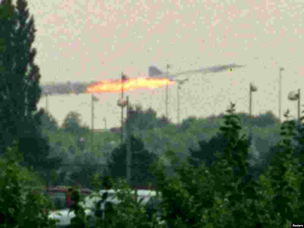 Flames come out of the Air France Concorde seconds before it crashed in Gonesse near Paris Roissy airport, July 25, 2000. The crash killed at least 110 people. The photo was taken by a Hungarian plane spotter whilst on holiday travelling across Europe.