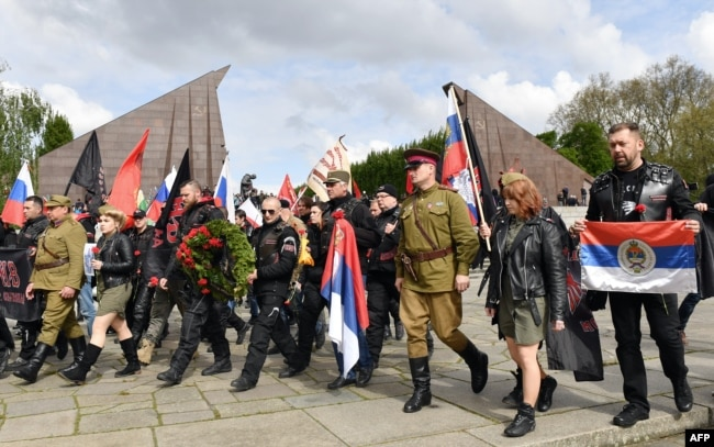 Night Wolves members and sympathizers take part in a provocative event commemorating Victory Day in World War II at a Soviet monument in Berlin in May 2017.