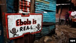 A sign placed in front of a home in a slum in Monrovia, Liberia, in September 2014.