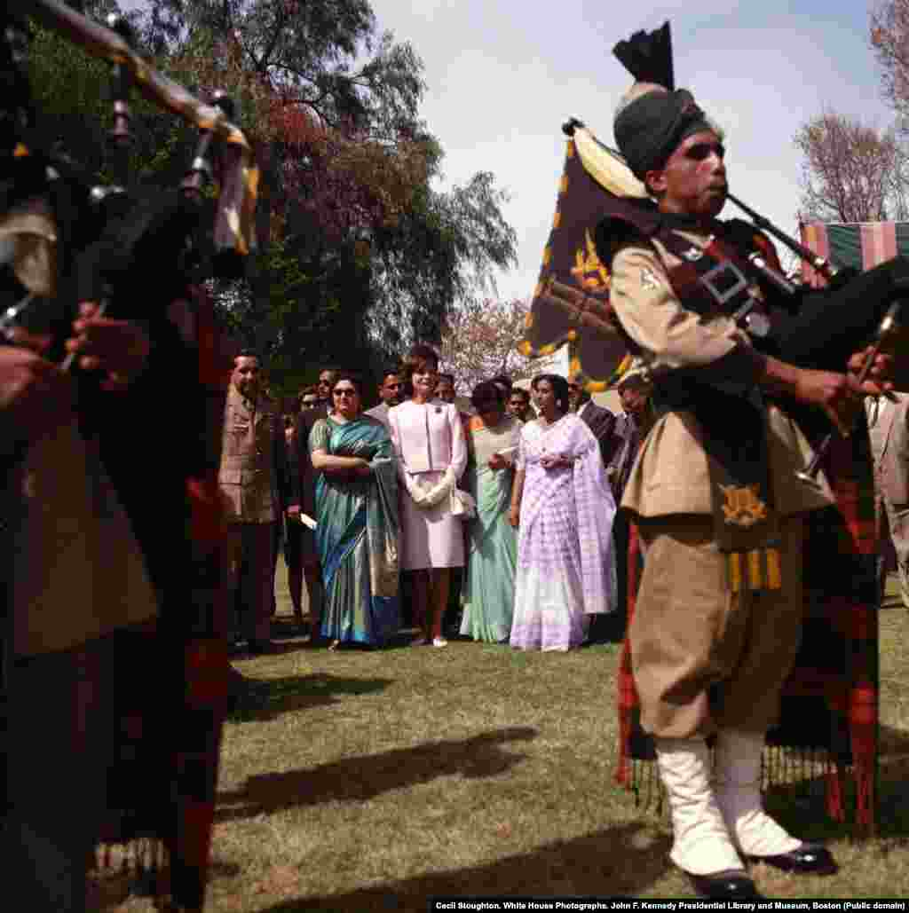 Jacqueline Kennedy listens to a performance of bagpipers at the Khyber Rifles officers' mess in Khyber Pakhtunkhwa, in northwestern Pakistan.