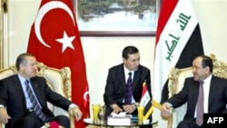 Iraqi Prime Minister Nuri al-Maliki (right) meets with his Turkish counterpart, Recep Tayyip Erdogan (left), in Baghdad