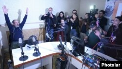 Armenia - Opposition leader Nikol Pashinian and his supporters seize the offices of Armenian Public Radio in Yerevan, 14 April 2018.