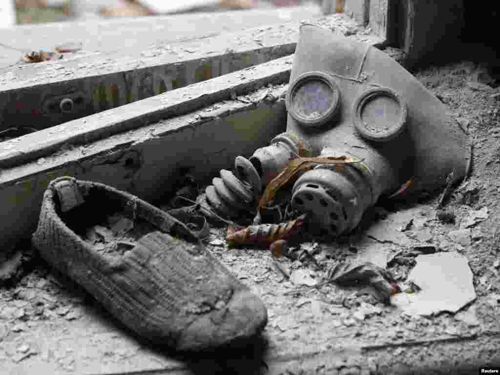 A child's gas mask and a shoe are seen at a kindergarten in the abandoned city of Prypyat near Chornobyl, shortly before Ukraine, Russia, and Belarus marked the 25th anniversary of the world's worst civil nuclear accident on April 26. (Reuters/Gle