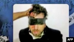 Фрагмент видеозаписи, обнародованной убийцами Витторио Арригони
