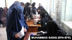Women cast their votes in Kandahar during the flawed parliamentary elections in Afghanistan in October 2018. A lack of credible information about the biometric system could hamper their participation in the upcoming presidential election.