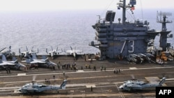 "South Korea Navy Sea Hawk helicopters aboard the aircraft carrier ""USS George Washington"" during July exercises"
